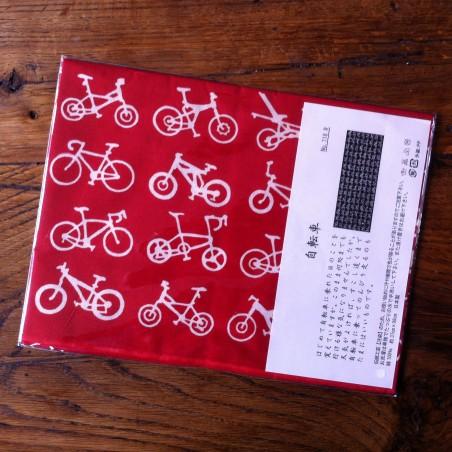Foulard motif Bicyclettes fond rouge.